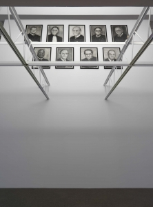 Nine drawings, one per then-current Supreme Court justice, hang on the wall just above a metal grid
