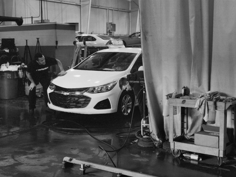 LaToya Ruby Frazier, *The Last Cruze in the detail shop at Sweeney Chevrolet, Boardman OH*, from *The Last Cruze*, 2019.