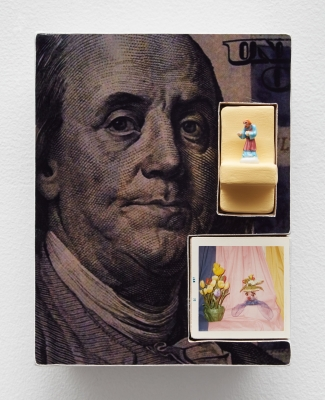 Mixed-media collage of a hundred-dollar bill close up, a small figurine perched on a stand and an image of flowers inserted