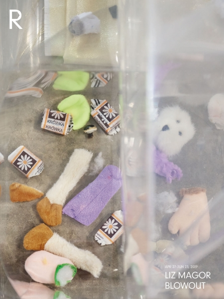 Close-up photo of scattered Polish fudge wrappers, candies, and limbs and heads of miniature stuffed animals