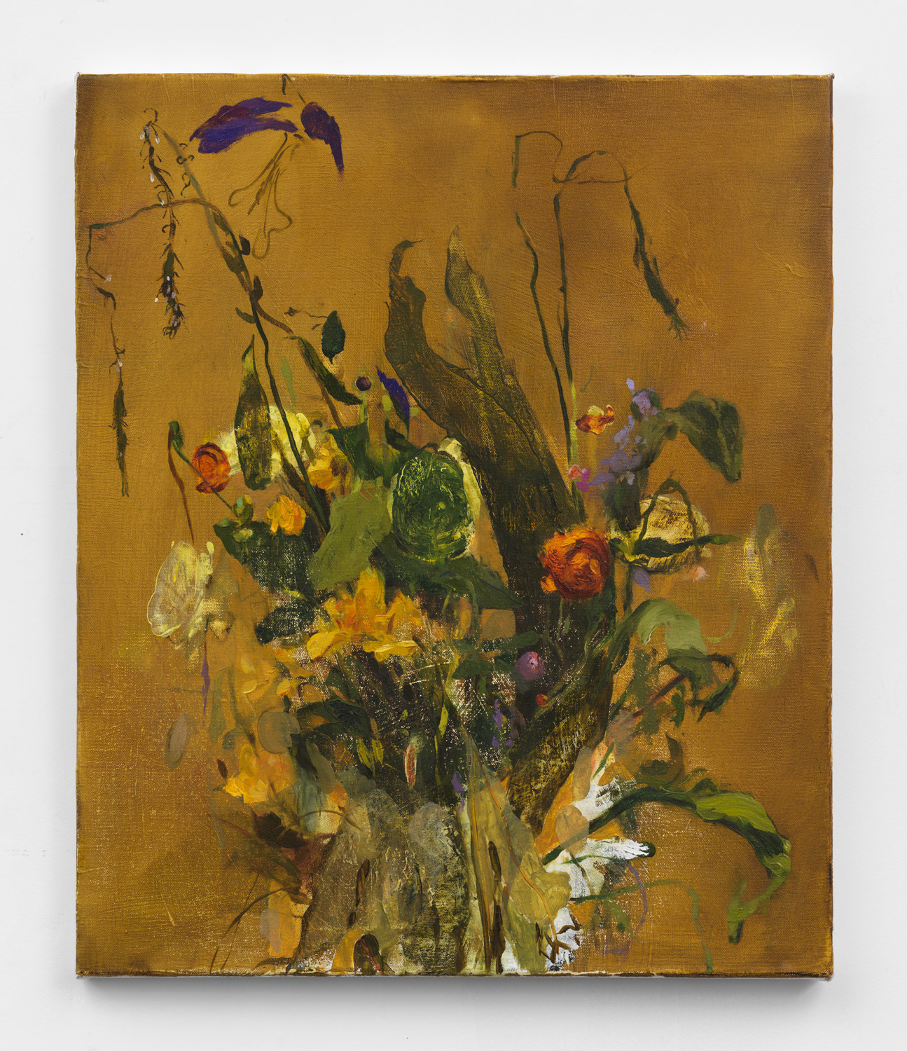 A bouquet of yellow, gold, green, orange and purple flowers against a mustard background