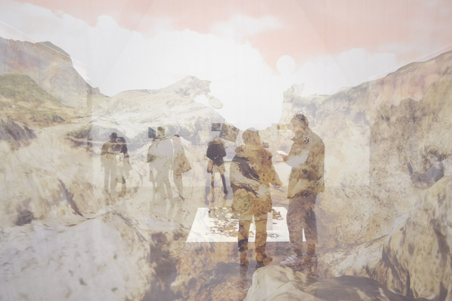 Visitors take in an exhibition viewed through a transparent fabric print of mountains with a pink sky.